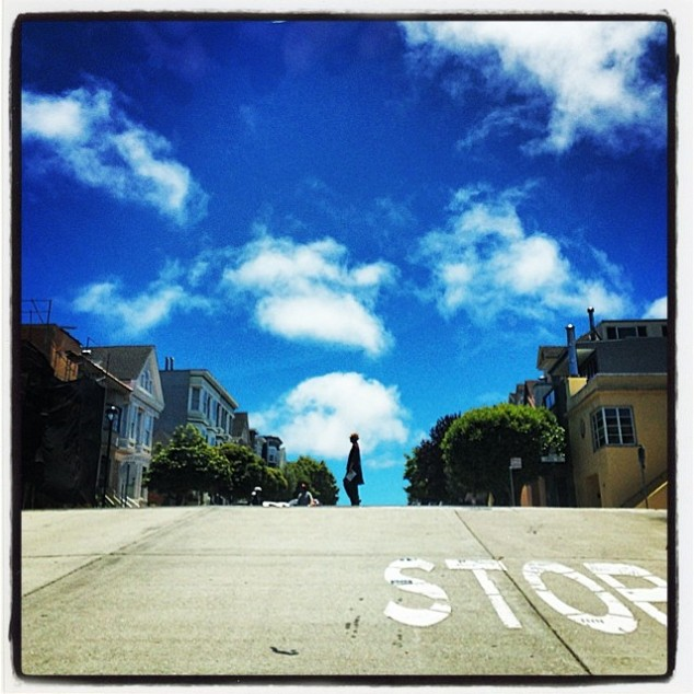 A pedestrian crossing the road on Potrero Hill. Photo credit: Lynn Friedman (Flikr)
